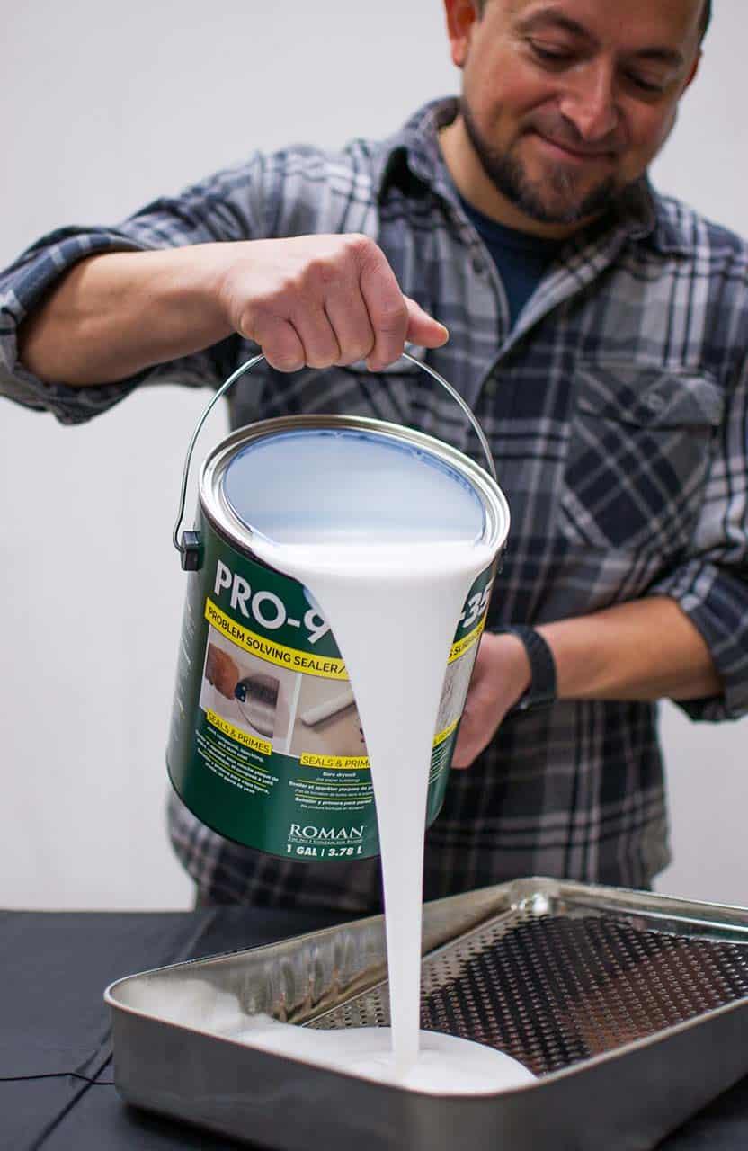 Man-pouring-1-gallon-PRO-999-Rx-35-Primer-Sealer